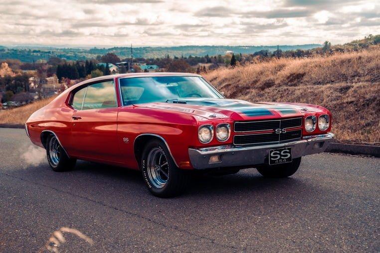 Красный автомобиль на дороге - 1970 годы